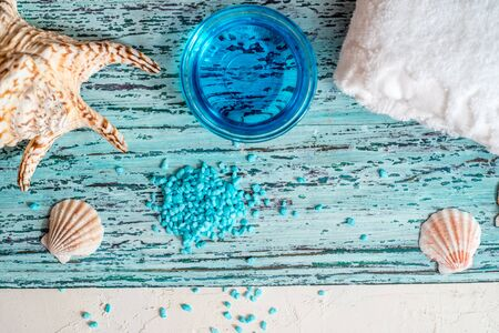 Sea shells and sea stars with sea-green sea salt isolated on white background 写真素材