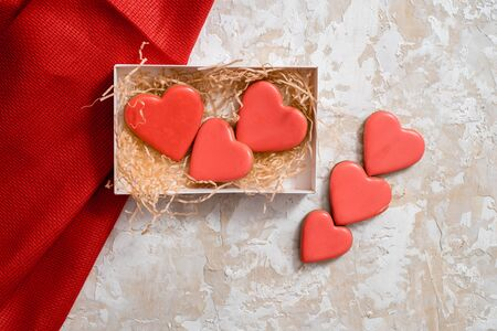 Sweet holiday card.Valentines Day. Gingerbread cookies in the shape of a red heart, with the image of a couple in love and a love letter.top view,flat lay, mockup