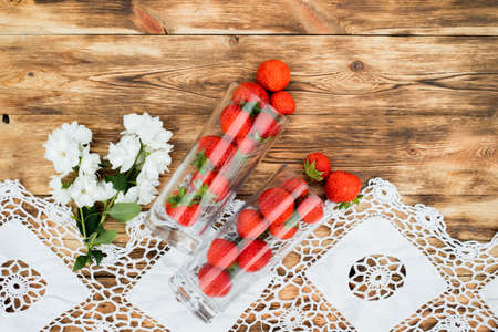 close up fresh Strawberries bright red in the glass on a wood background. Archivio Fotografico
