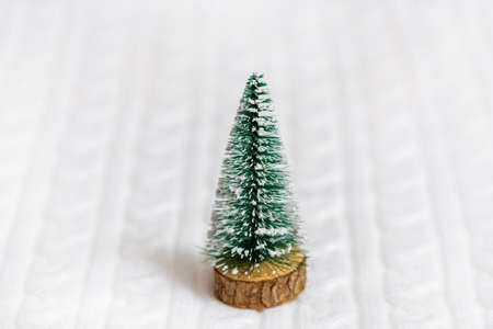 White Knitted Fabric. wooden spruce. New Year card, copy spase Archivio Fotografico