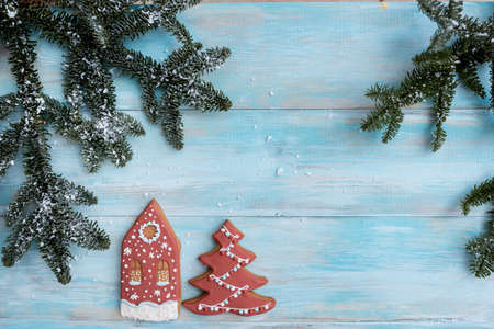 Christmas gingerbread on a white mitten. on a blue wooden background. New Year card Archivio Fotografico