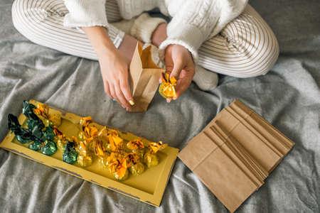Cute girl making handmade advent calendar at home