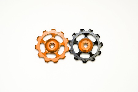 Black and golden rollers, gear for bicycle rear derailleur isolated on a white background