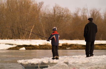 Father and son go fishing on river. Stock Photo - 2366791