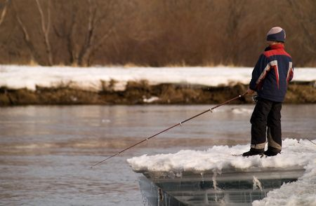 Boy by springtime goes fishing in river. Stock Photo - 2366789