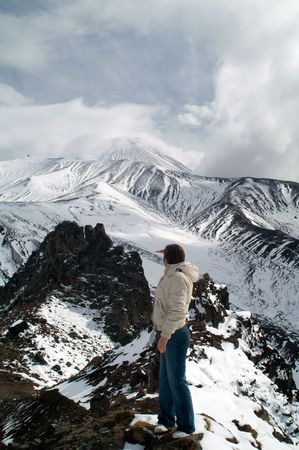 onward: woman travels on mountain and looks on vulcan onward Stock Photo