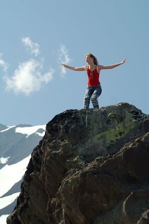 Girl is found on enormous stone and embraces sky Stock Photo - 2455874