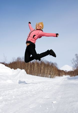 Glad girl jumps in air on background of the vulcan Stock Photo - 2545752