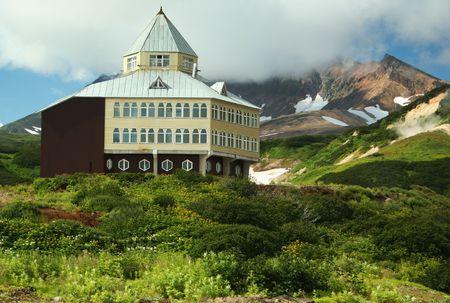 fervour: hotel beside foots of the mountain in valley Mutnovskaya Stock Photo