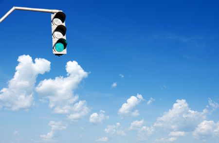 Traffic lights in front of blue sky Stock Photo