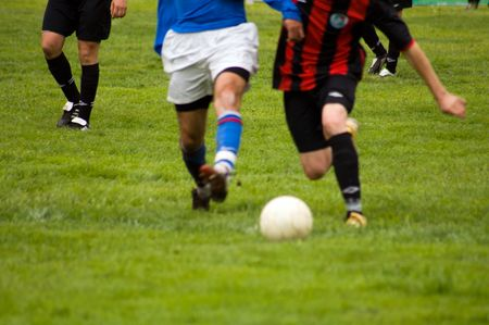 Detail of a soccer game with players in action