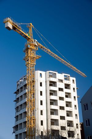 erect: lifting crane on building of the new house
