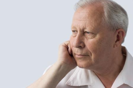 upset man: portrait of a senior person