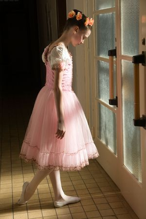 dancing shoe: young ballerina in tutu before appearance