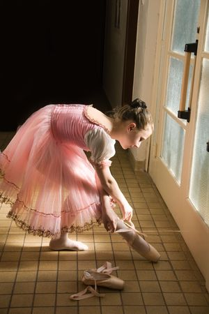 young ballerina puts on pointe  before appearance Stock Photo - 4207829