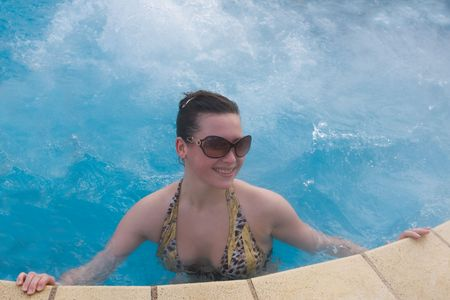 seething: girl in pool with hot mineral medical water Stock Photo