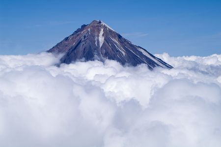 ascent: top of the volcano Koryaksky on kamchatka above clouds Stock Photo