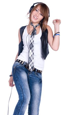 cool teenager listening to music and dancing photo