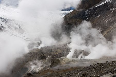 inwardly: man goes inwardly in crater of the vulcan Mutnovsky on Kamchatka