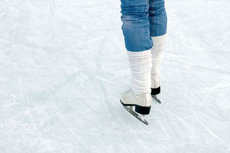 �loseup of figure skating ice skates in action outdoors Stock Photo