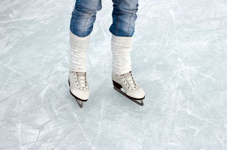 closeup of figure skating ice skates in action outdoors Stock Photo