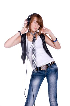 portrait of the girl listenning music in headphones photo