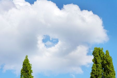 clouds making: white clouds making a heart shape againt a blue sky Stock Photo