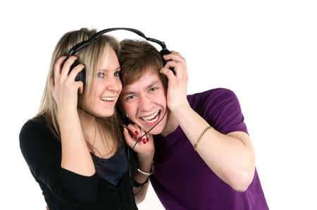 younger pair listens music in headphones photo