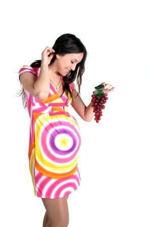 Portrait of young sexy glamour beautiful pregnant woman with grape - white background photo