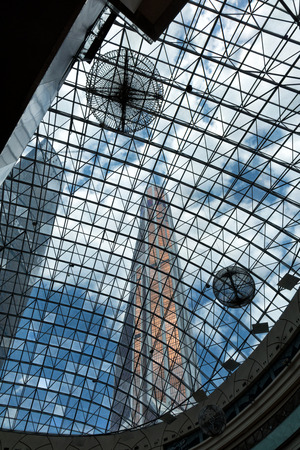 steel blue: underside panoramic and perspective view to steel blue glass high rise building skyscrapers, industrial architecture Stock Photo