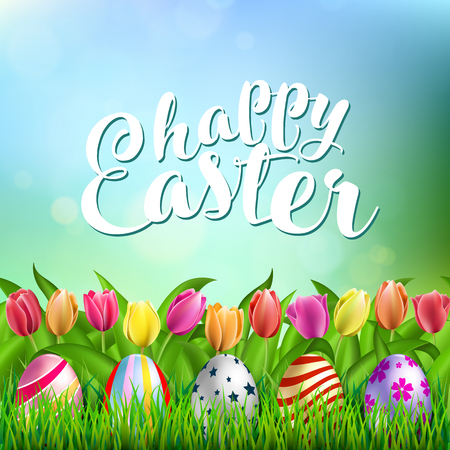 Colorful Easter Eggs on Fresh Green Grass with tulip on spring background and Happy Easter lettering