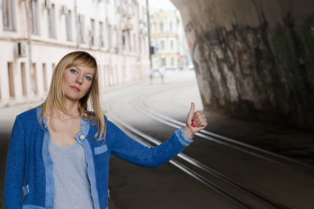 Young traveling woman in the urban landscape.