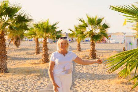 Portrait of smiling happy senior woman on resort. Greece. Crete. Rethumno.