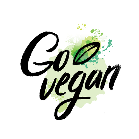 Words GO VEGAN in simple and cute frame with green branches and leaves with watercolor elements in green color. Vectorized watercolor drawing.