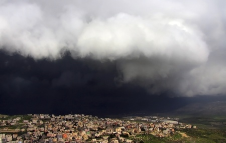 black storm cloud hanging over kfar Kana in Israel Stock Photo - 12023242