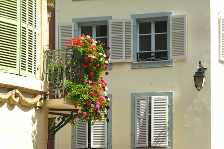 flowers on the windows of the historical town of Colmar in France photo