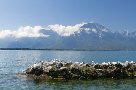 landscape with a lake and mountains, near the town of Montreux photo