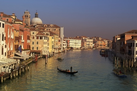 Canal in Venice.gondolier at sunset transports lovers photo