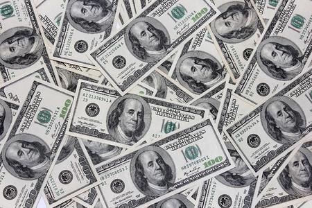 one hundred dollar bill American.hundreds of bills on the floor
