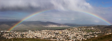 rainbow over the Arab village of Cana in the Galilee region of Israel  photo