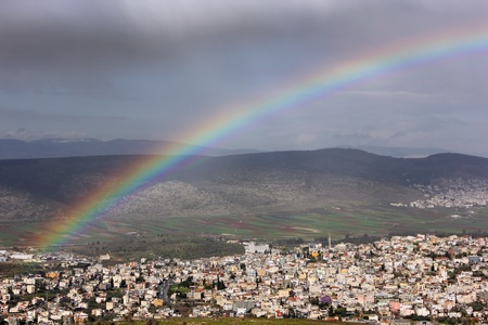 rainbow over the Arab village Stock Photo - 12534409