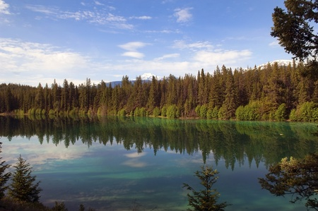 reflection of the sky and forests in the Emerald lake in Sabwatcha canyon, Canada Stock Photo - 12766033
