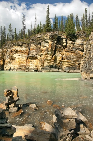 rocky shores of a mountain river in the Canadian Rockies