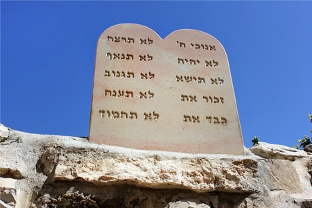 stone slab, in view of an open book, on which are engraved in Hebrew, nine biblical precepts Editorial