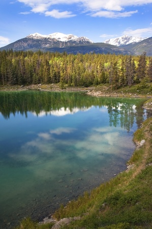 reflection of the forest and the sky in the emerald lake  Banff Alberta, Canada Stock Photo - 12931183