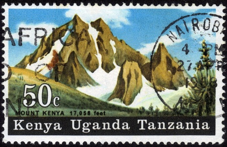 Kenya, Uganda, Tanzania-circa 1968   A stamp printed in Kenya shows image of Mount Kenya Stock Photo - 13003485