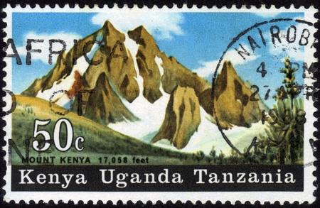 Kenya, Uganda, Tanzania-circa 1968   A stamp printed in Kenya shows image of Mount Kenya Stock Photo - 13003485