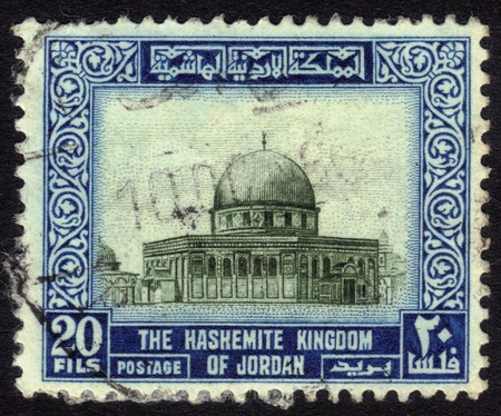 JORDAN-CIRCA 1954:A stamp printed in Jordan shows image of Al-Aqsa Mosque also known as al-Aqsa, is the third holiest site in Sunni Islam and is located in the Old City of Jerusalem,series, circa 1954. Stock Photo