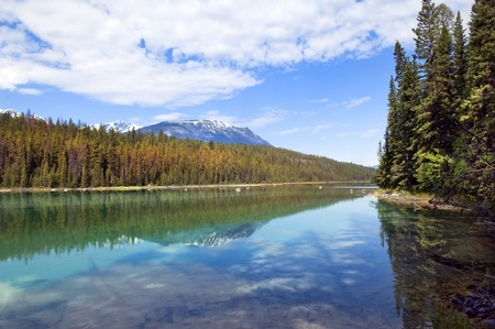 beautiful reflection of the sky, snowy mountain peaks and forests in the purest lake of the Canadian Rockies Stock Photo - 13180654