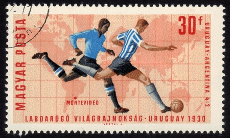 Hungary - CIRCA 1966  a stamp printed by Hungary shows football players World football cup in Montevideo 1930, series, circa 1966